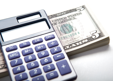 solvency: dollars and calculator work close up Stock Photo
