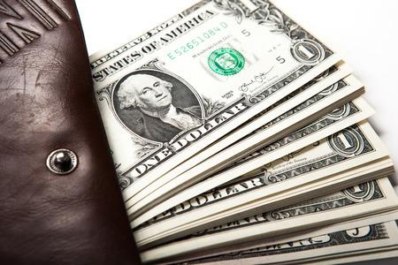 spending money in your wallet close up Standard-Bild