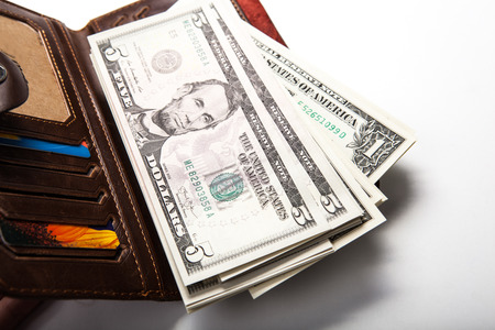solvency: spending money in your wallet close up Stock Photo