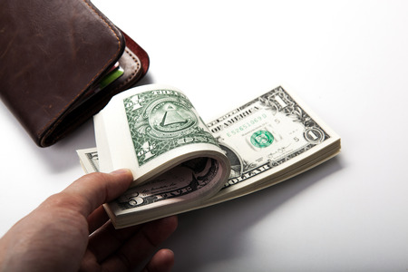 solvency: hand holds a dollar bill close up Stock Photo