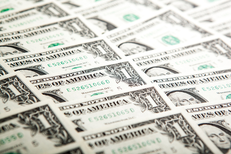solvency: background heap of dollars close up