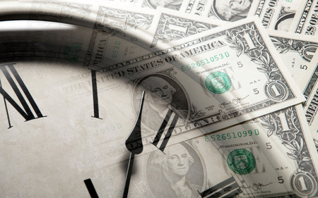 creditworthiness: clock on the background of banknotes dollars close up Stock Photo