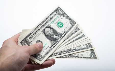 creditworthiness: hand holds a dollar bill close up Stock Photo