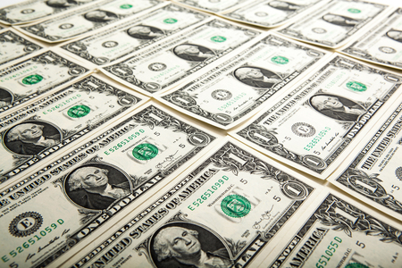 creditworthiness: background heap of dollars close up