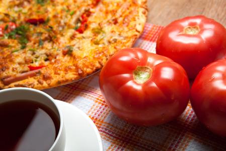 nosh: breakfast pizza and tea close up