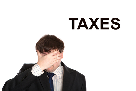 onset: business in stress with title taxes on a white background