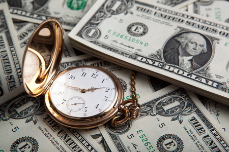 make an investment: gold watch and dollar bills close up Stock Photo