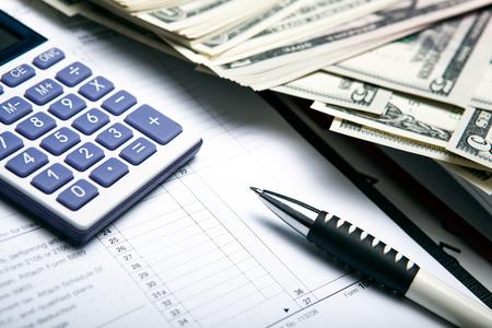 creditworthiness: dollars and calculator work close up Stock Photo