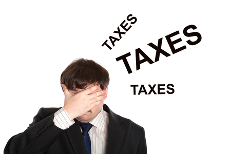 doldrums: business in stress with title taxes on a white background