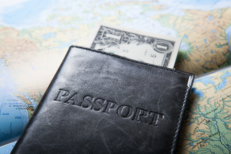 solvency: passport with dollar bills Stock Photo