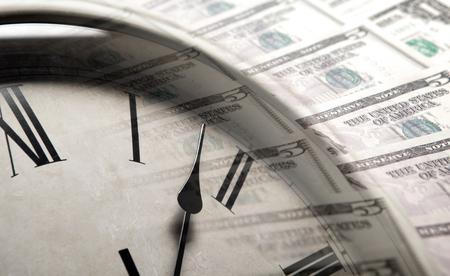 ドル紙幣の背景に時計をクローズ アップ 写真素材