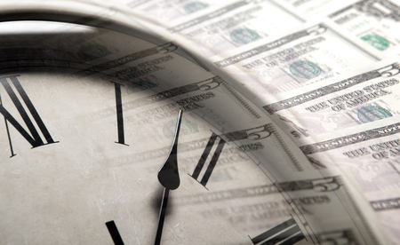 clock on the background of banknotes dollars close up Standard-Bild