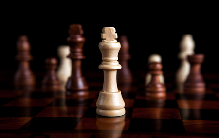 play acting: chess pieces with the king in the center Stock Photo
