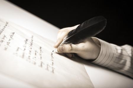 melancholia: writer writes a fountain pen on paper work close up