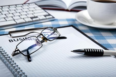 workbook: eyeglasses and pen on the workbook close up