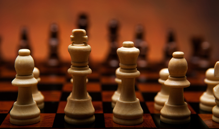 sureness: chess game with pieces on the board close up