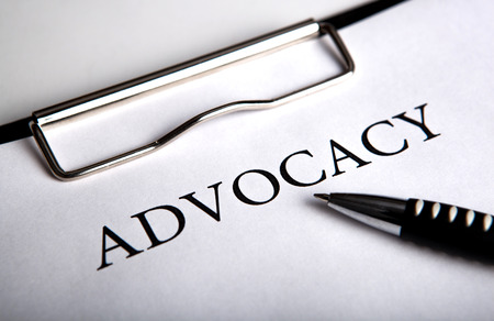 title: document with the title of advocacy and pen close up Stock Photo