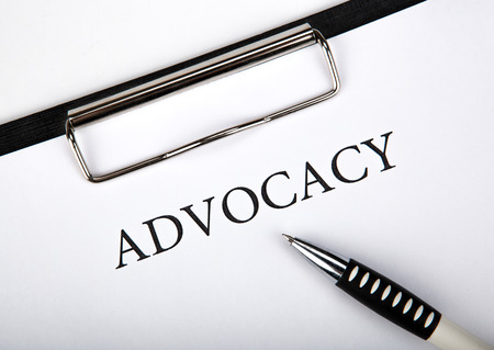 justification: document with the title of advocacy and pen close up Stock Photo