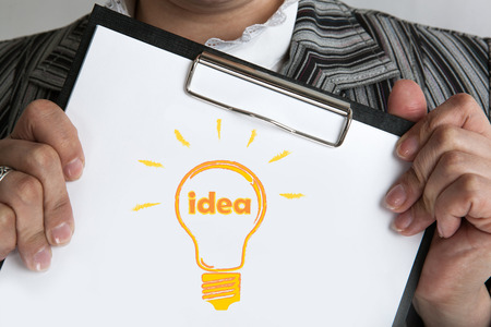 authorship: man holding a folder icon ideas close up