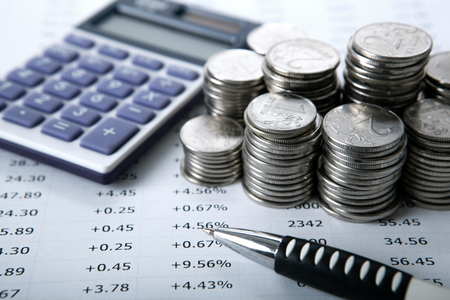 emolument: stacks of Russian rubles with calculator close up Stock Photo