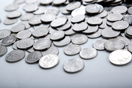 emolument: pile of coins on a white close up Stock Photo