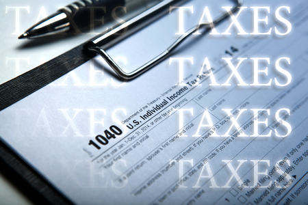 imposition: office work and filling in tax form with inscriptions taxes close up