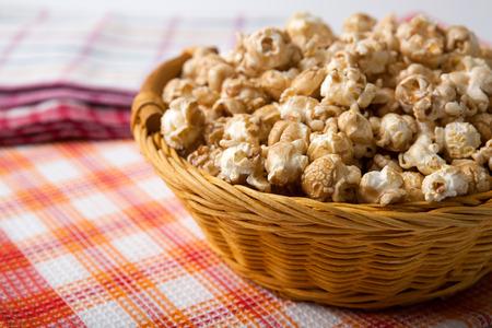 dulcet: caramel popcorn in a basket on a napkin close up