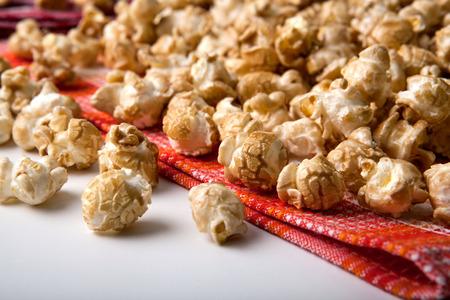 dulcet: large caramel popcorn on a napkin close up