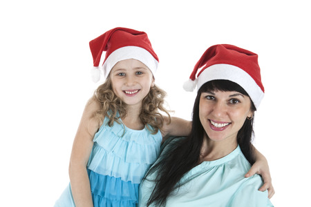 mother with a little daughter in Christmas caps on a white background