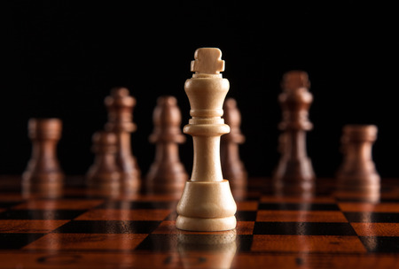 chess pieces with the king in the center Stock Photo
