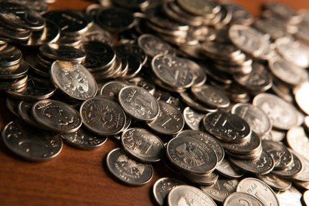 emolument: bunch of Russian rubles coins on a wooden surface close up