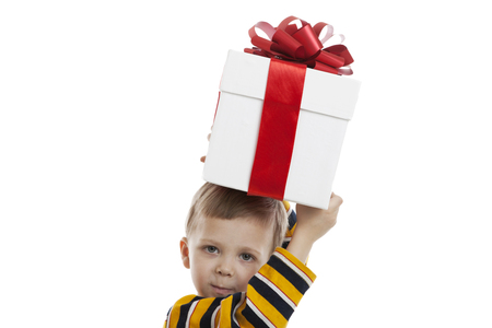 boxing day: portrait of a little boy with a gift box on a white background