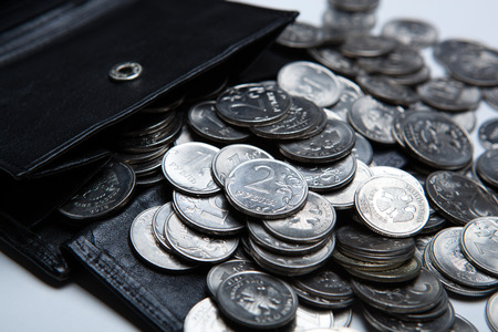 emolument: pocket purse with a bunch of Russian coins close up