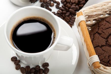 cup of coffee and beans and chocolate cookies Stock Photo