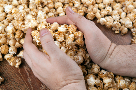gaining: people gaining a bunch of popcorn close up