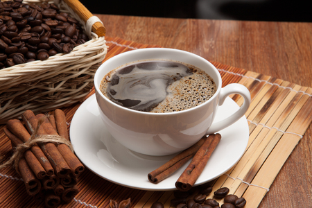 cup of coffee, spice and roasted beans in the basket Stock Photo