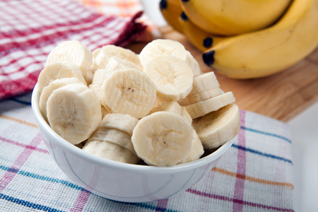 Slices of fresh bananas in a bowl close up Stock Photo