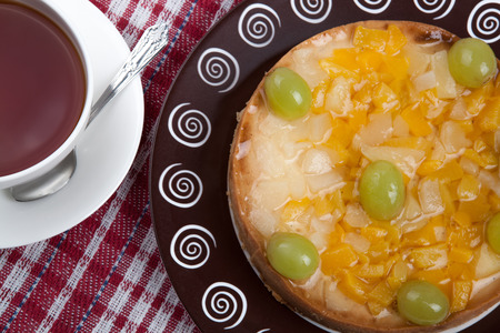 dulcet: still life of freshly baked pie and cup of tea close up