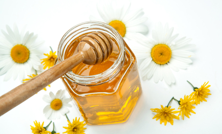 dulcet: fresh honey in a bank and honey stick and flowers