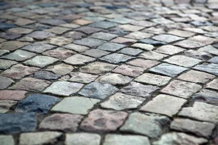 抽象的な背景の古い玉石の舗装道路をクローズ アップ