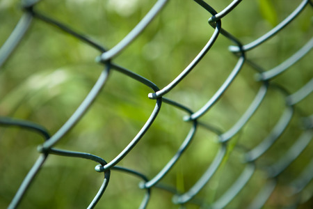 Mesh fence as a symbol of protection close up