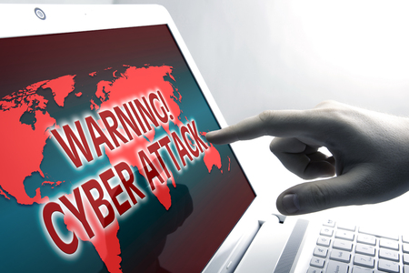 human finger on the Tablet PC with inscription warning cyber attack Stock Photo