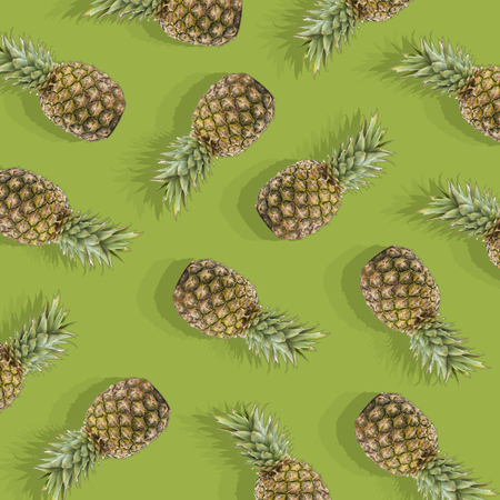 illustration in the form of green background with image of ripe pineapple Фото со стока