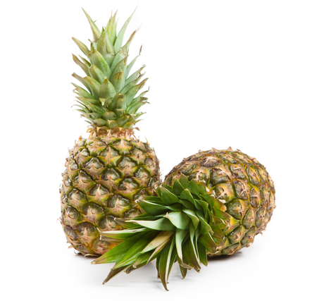 two big pineapples on a white background isolated Фото со стока