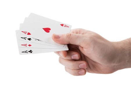 Fan of playing card aces in hand on a white background isolated