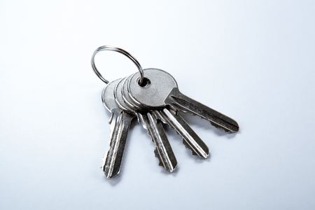 keys from the apartment on a white table closeup