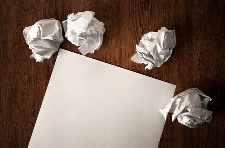 paper and a crumpled paper on a table