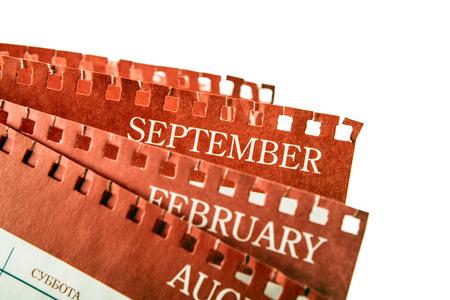 big pile of printed wall calendar sheets closeup 写真素材