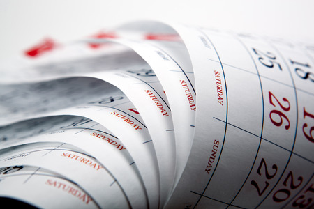 big pile of printed wall calendar sheets closeup Stock Photo