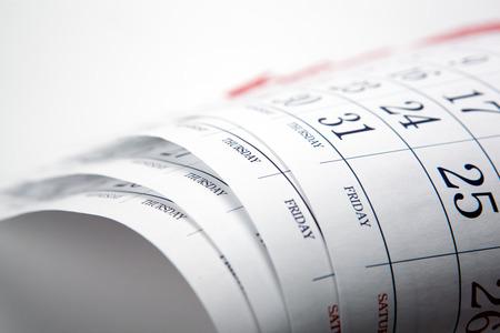pile of printed wall calendar sheets closeup Stock Photo